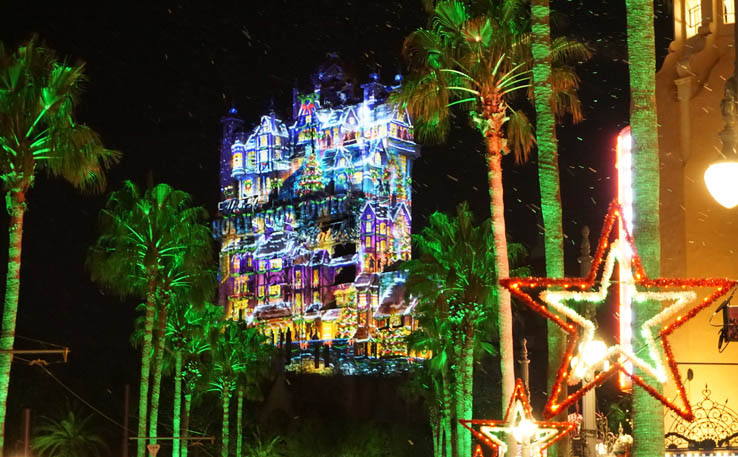 Festive projections on the Hollywood Tower Hotel at Disney's Hollywood Studios Park.