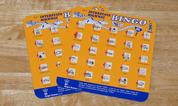 Travel bingo cards to play game in cars, on trains and airplanes, and in airports