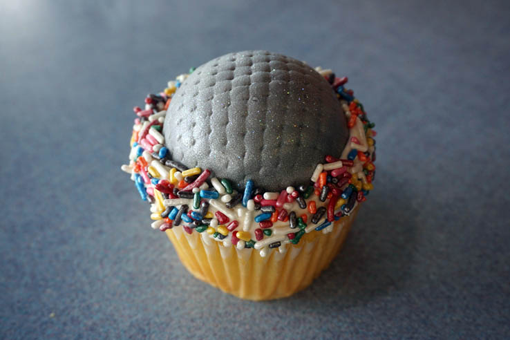 Cupcake shaped like Spaceship Earth attraction at Disney World's EPCOT theme park.