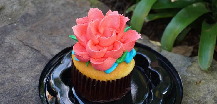 Rivers of Light vanilla cupcake with flower frosting at Disney World's Animal Kingdom.
