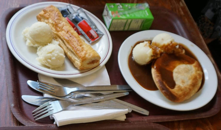 Minced beef pie, mash, and sausage roll at Goddard's, Greenwich, UK.