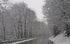 Country road in Virginia during the winter time with snow on the ground and the trees.