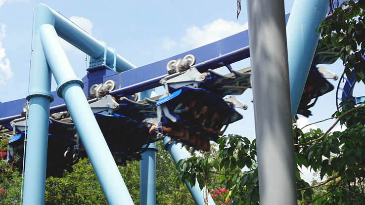 Riders flying on Manta roller coaster at SeaWorld Orlando